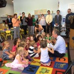 Mayor Fischer reads to preschoolers at Providence Childcare and Preschool in Jeffersontown on Friday, after praising the school for making reading a priority.