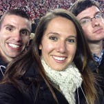 Outgoing Clarion-Ledger high school sports and recruiting editor Courtney Cronin poses with C-L Mississippi State beat writer Michael Bonner (left) and Bob Carskadon (right) at Bryant-Denny Stadium in November 2014.