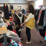 Leslie Wilson shows her mother, Glenda Feagin, some of the latest apparel.