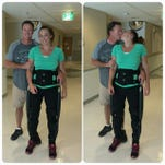 Amy Van Dyken-Rouen takes her first steps since the accident.