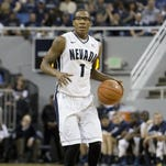 Nevada's Marqueze Coleman looks up the court against UNLV in the regular-season finale on March 8 at Lawlor Events Center.
