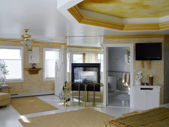 The master suite has a fireplace.