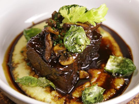 Braised beef short rib in a red wine reduction served on creamy ...