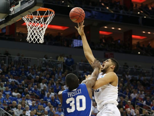 Kentucky Wildcats forward Karl-Anthony Towns (12) shoots the ball against Hampton Pirates forward Jervon Pressley (30) during the second half in the second round of the 2015 NCAA Men's Tournament at KFC Yum! Center.
