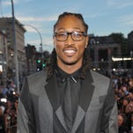 "Future arrives at the MTV Video Music Awards at Barclays Center in the Brooklyn borough of New York on Aug. 25, 2013. Future thinks his new star-laden album ""Honest"" is a time capsule. ""This album isn't even about the hits, it's about the moments,"" he said."