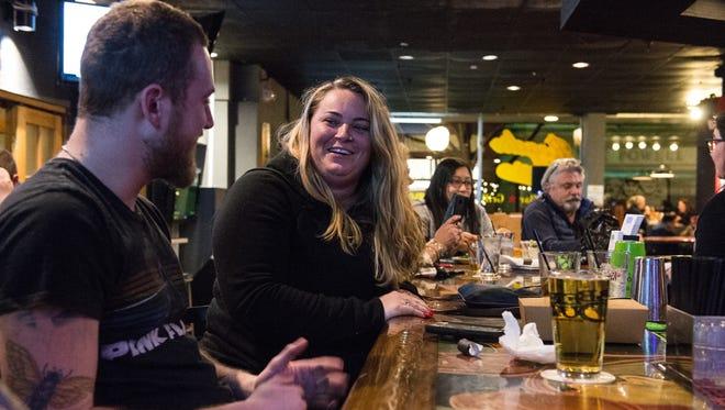 Evan Psota and Tory Stone enjoy a drink at Roadie Joe's on West Main Street on Friday, Feb. 9, 2018.