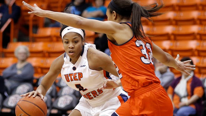 UTEP guard Lulu McKinney tries to drive past UTSA guard Loryn Goodwin in the first half of their game Sunday at the Don Haskins Center. UTEP lost in overtime 83-81.
