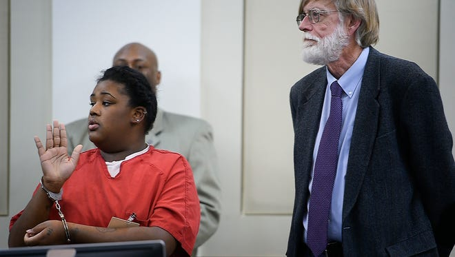 Antwana Smith, charged in the 2015 fatal shooting of 14-year-old Treyonta Burleson, pleads guilty to second degree murder with her defense attorney Mike Engle Thursday Jan. 19, 2017, in Nashville, Tenn.