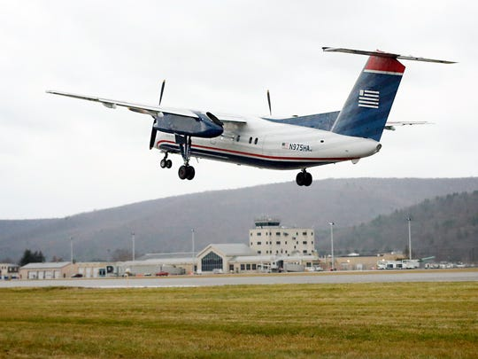 An American Airline plane headed to Philadelphia takes off from the Elmira Corning Regional Airport on Dec. 2.