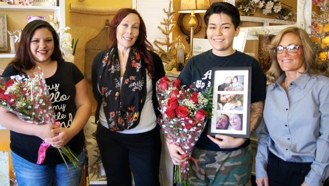 """Winners of the Silver City Floral Co. """"Best Love Story"""" received a half-dozen roses on Saturday at the florist's shop. Pictured are winner Samantha Garcia, from left, owner La Rea Henderson, winner April Vigil, and shop employee Janice Worley. Not pictured is winner Linda Marquez-Tollefson."""