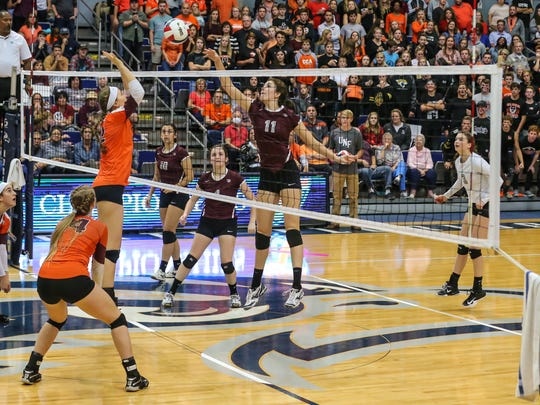 First Baptist Academy's Paige Scullin (11) returns the ball to Christ's Church Academy during the Girls Volleyball 3A State Championship game at the University of North Florida in Jacksonville, Fla., on Thursday, Nov. 16, 2017. (For The Naples Daily News/Gary Lloyd McCullough)