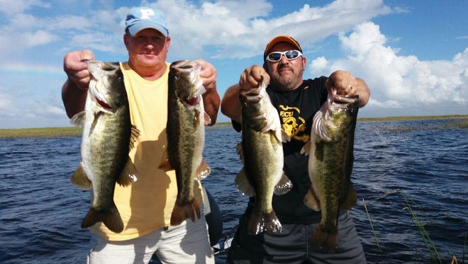 Chuck Carnahan, left, and Andy Retucci, of New Jersey, enjoyed a really steady bass bite Sunday while fishing with Capt. Mike Shellen of Okeechobeebassfishing.com.