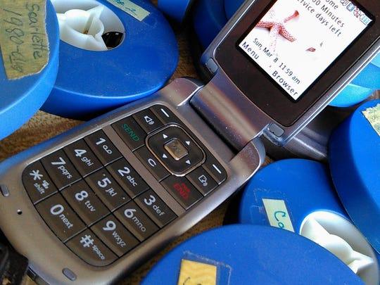 A well-worn flip-phone.