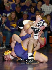 Northern Iowa's Logan Ryan, right, and Iowa State's Chase Straw get tangled up in the 157 pound match in a Big 12 wrestling dual at the West Gym Saturday, Feb. 10, 2018, in Cedar Falls, Iowa.