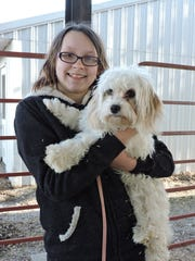 """""""Emma and Ava"""": Emma Nady of New Virginia gives Ava, her Bichon-King Cavalier mix, some encouragement before a recent practice for the Warren County Fair dog show."""