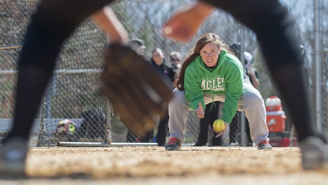 Winslow Township High School softball coach Candi Steinhauer goes over a fielding technique with Winslow Township softball player Julia McKelvey during practice on Wednesday.