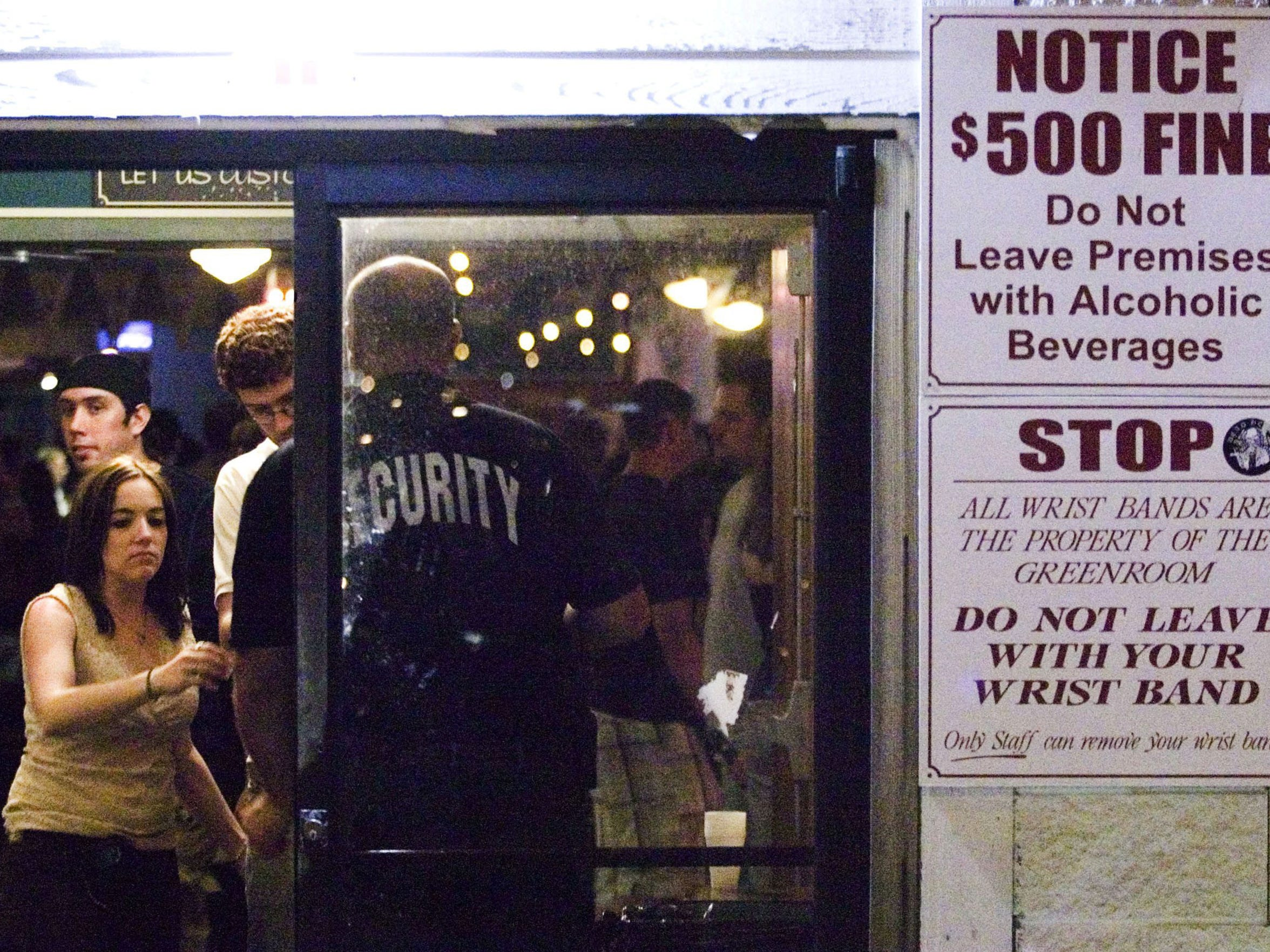 A doorman collects wristbands from Sawmill Cafe patrons in this file photo.