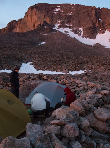 Campers prepare for their climb of Longs Peak in Rocky Mountain National Park from the boulder field back country campsite on Friday, July 19, 2017.
