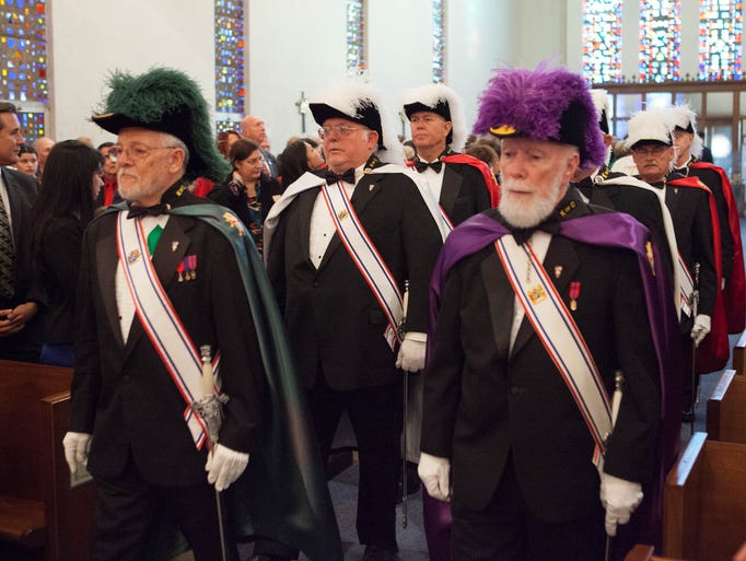 The Knights of Columbus lead the entry processin at