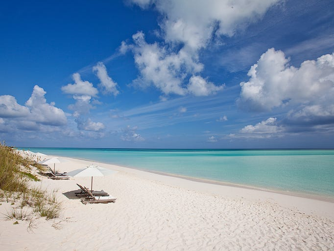 The beach at Parrot Cay, a private island resort near