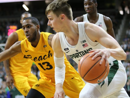 Michigan State's Matt McQuaid drives to the basket against Long Beach State's Barry Ogalue on Thursday, Dec. 21, 2017, at Breslin Center.