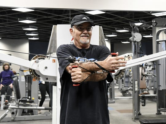 Lifestyle Center member Ron Ruiz uses a cable-cross