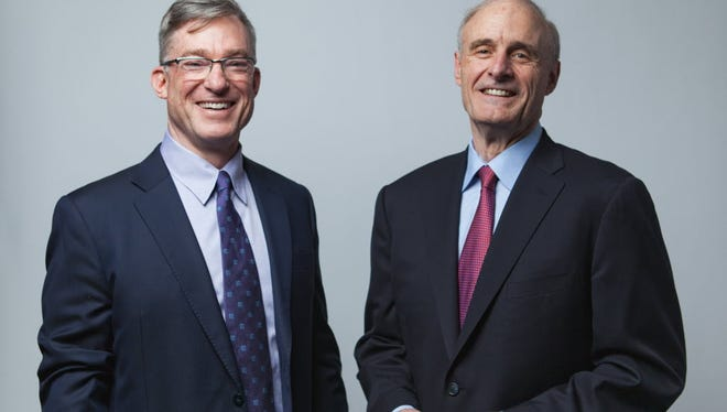 Blake Moret (left) succeeded Keith Nosbusch (right) as the CEO of Rockwell Automation last year.