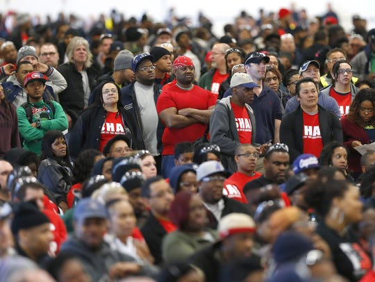 Members of the United Auto Workers listen to Chrysler