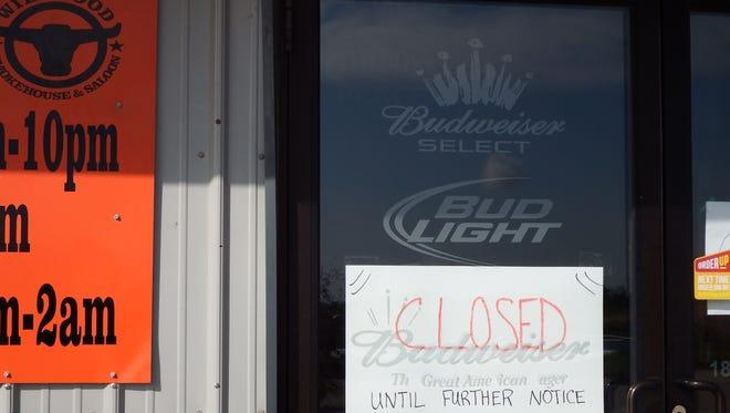The front door of Wildwood Smokehouse & Saloon in Iowa City on Tuesday, Oct. 6, 2015.
