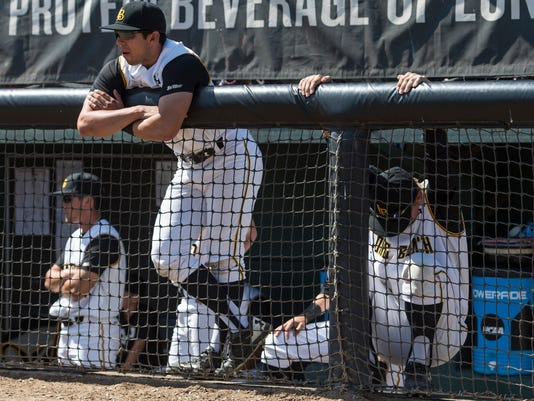 Long Beach State players react to a loss to Cal State Fullerton in the deciding game of the NCAA college baseball tournament super regional in Long Beach, Calif., Sunday, June 11, 2017. (Kyusung Gong/The Orange County Register via AP)