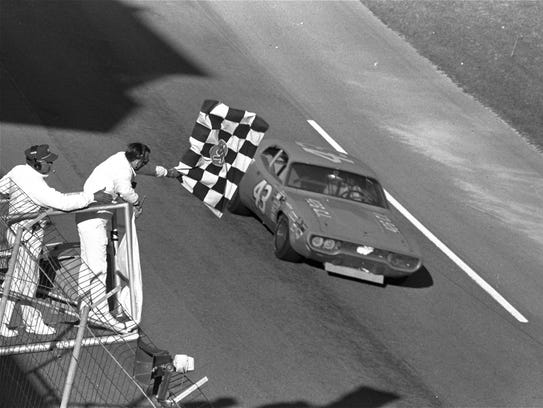 Richard Petty takes the checkered flag to win the 1971
