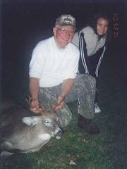 Maddie Crocenzi (right) as a kid with her grandpa (left), Larry Brothers, and his buck.