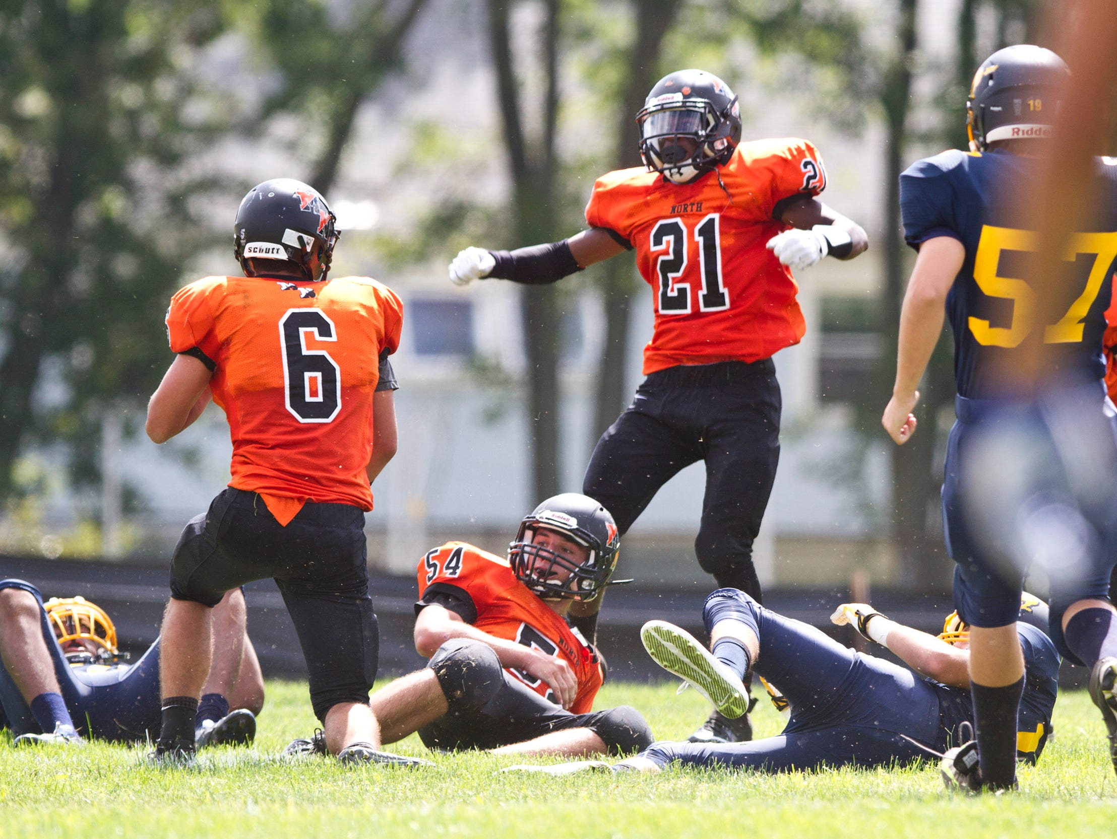Middletown North's Josh Gomez (6) Jacob Dean (54) and Dwight Wilkerson (21) celebrate a touchdown after a blocked punt late in the second quarter. Middletown North vs Marlboro football. Marlboro, NJ Saturday, September 19, 2015 @dhoodhood