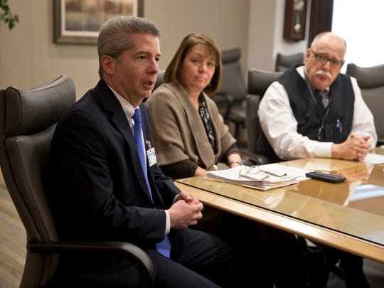 CentraState Medical Center is trying to cut down on the high rate of its patients who get sick or hurt in the hospital. (left to right) Thomas W. Scott, senior vice president and chief operating officer; Cathleen Janzekovich, assistant vice president of nursing; and Carl Ausfahl, assistant vice president of quality and performance improvement, meet to discuss what the Freehold Township hospital is doing.