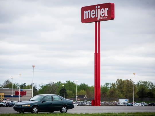 A Meijer pole sign stands on McGalliard Road Friday.