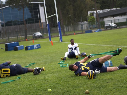 Michigan football players Michael Owenu, from left Lavert Hill and Ben Bredeson during their first practice in Rome at Giulio Onesti Training Center on Thursday, April 27, 2017.
