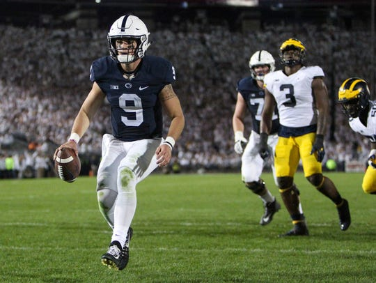 Penn State QB Trace McSorley (9) runs the ball into