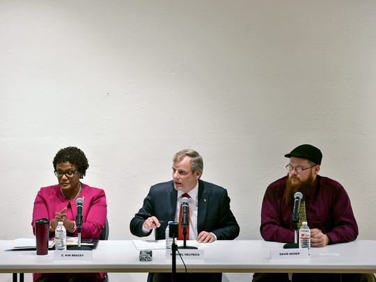 From left, Kim Bracey, Michael Helfrich and Dave Moser participate in a York mayoral candidate debate Thursday, Oct. 26, 2017, in Marketview Arts in York. The three candidates — Democratic incumbent Kim Bracey, Republican candidate Michael Helfrich and Libertarian candidate Dave Moser — are running for mayor of York in the Nov. 7 election.
