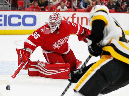 Red Wings goaltender Jimmy Howard (35) makes a save