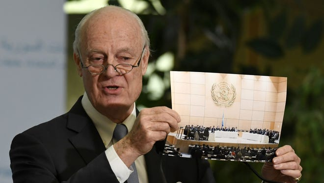 U.N. Special Envoy of the Secretary-General for Syria Staffan de Mistura shows a picture during a press conference as part of the Intra-Syrian peace talks at the European headquarters of the United Nations in Geneva, on March 3, 2017.