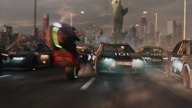 "Cars drive a race track attempting to unlock a key in ""Ready Player One."""