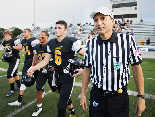 John Mantica, right, leads Bishop Verot High School