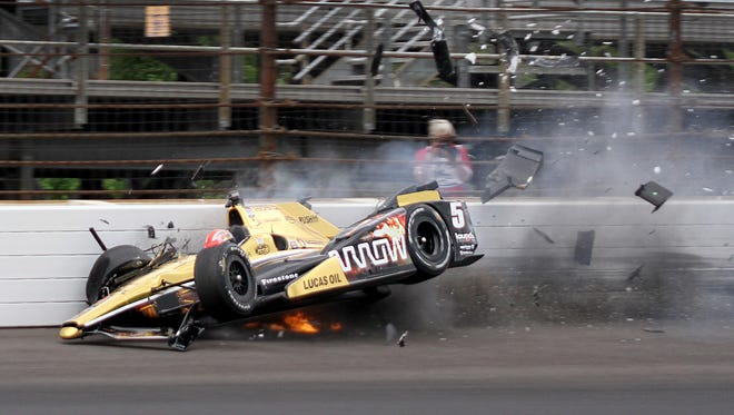 James Hinchcliffe hits the wall coming out of turn 3 during practice for the 99th Indianapolis 500 on Monday, May 18, 2015, at Indianapolis Motor Speedway.