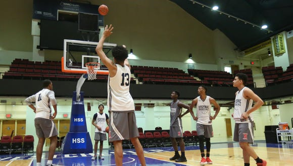 Stepinac's Xavier Wilson puts up a shot during practice