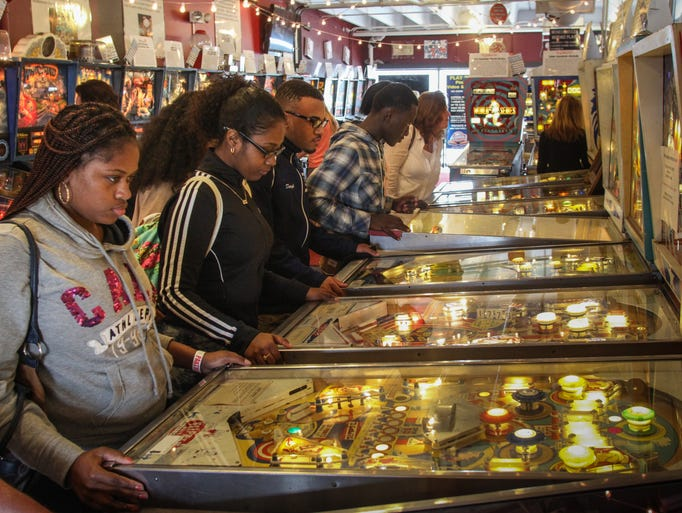 Students in Brookdale community College's College Readiness Program in the Long Branch school system and Academy Charter enjoy the Silverball Pinball Museum in Asbury Park after studying the history and math of the sport.