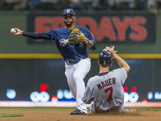 FILE - In this Aug. 10, 2017, file photo, Milwaukee Brewers' Jonathan Villar turns the double play after getting Minnesota Twins' Joe Mauer at second base during the fourth inning of a baseball game, in Milwaukee. econd base is one of the few areas where there will be spring training competition for the Milwaukee Brewers. Jonathan Villar is trying to bounce back from a subpar 2017 season, while utility players Eric Sogard and Hernan Perez are also in the mix.  (AP Photo/Tom Lynn, File)