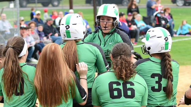 Paige Halliwill is met at home plate by her Mogadore teammates after she hit a home run April 17, 2019, against Crestwood.