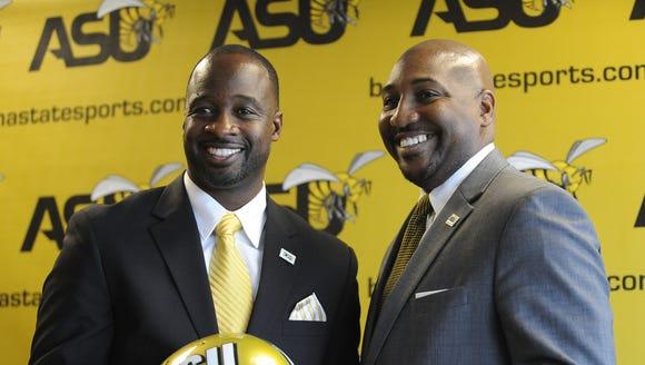 ASU interim athletic director Melvin Hines, right,