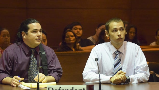 Brandon James Flaherty, right, enters a plea of not guilty at his arraignment hearing in the Superior Court of Guam in October 2014.