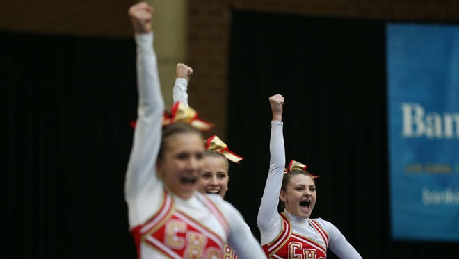 Carlisle's Kylie Brown competes alongside her team in the cheer/dance portion of the 2015 Iowa High School Cheerleading State Championships on Saturday, Nov. 7, 2015 at the Jacobson Building on the Iowa State Fairgrounds.